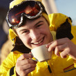 Teenage Boy Enjoying Hot Drink In Café At Ski Resort — Stock Photo
