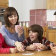 Family Playing Cards In Kitchen — Stock Photo