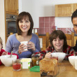 Family Eating Breakfast Together In Kitchen — Stock Photo #11893244