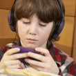 Boy Playing With Hand Held Games Console Whilst Eating Breakfast — Stock Photo