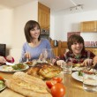Family Eating Lunch Together In Kitchen — Stock Photo #11893306
