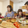 Family Eating Lunch Together In Kitchen — Stock Photo