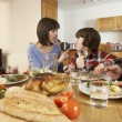 Stock Photo: Family Having Argument Whilst Eating Lunch Together In Kitchen