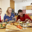 Teenage Family Eating Lunch Together In Kitchen — Stock Photo #11893321