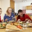 Stock Photo: Teenage Family Eating Lunch Together In Kitchen