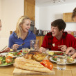 Teenage Family Eating Lunch Together In Kitchen — Stock Photo #11893325