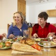 Teenage Family Eating Lunch Together In Kitchen — Stock Photo #11893329