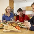 Teenage Family Eating Lunch Together In Kitchen — Stock Photo #11893333
