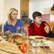 Teenage Family Having Argument Whilst Eating Lunch Together In K - Stock Photo