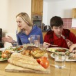 Stock Photo: Teenage Family Having Argument Whilst Eating Lunch Together In K