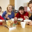 Family Eating Breakfast Together In Kitchen — Stock Photo #11893364