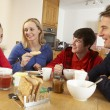 Family Eating Breakfast Together In Kitchen — Stock Photo #11893368