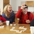 Family Playing Dominoes In Kitchen — Stock Photo
