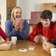 Family Playing Cards In Kitchen — Stock Photo #11893413