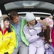 Teenage Family Sitting In Boot Of Car Wearing Winter Clothes — Stock Photo