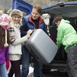 Family Unloading Luggage From Transfer Van Outside Chalet On Ski — Stock Photo #11893446