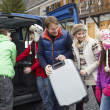 Family Unloading Luggage From Transfer Van Outside Chalet On Ski - Stock Photo