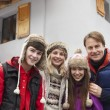 Portrait Of Family Standing Outside Chalet On Ski Holiday — Stock Photo