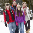 Teenage Family Walking Along Snowy Street In Ski Resort — Stock Photo #11893460