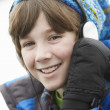 Boy Wearing Headphones And Listening To Music Wearing Winter Clo — Stock Photo #11893536
