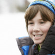 Boy Wearing Headphones And Listening To Music Wearing Winter Clo — Stock Photo #11893539