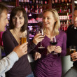 Group Of Friends Enjoying Drink Together In Bar — Stock fotografie