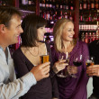 Group Of Friends Enjoying Drink Together In Bar — Foto de Stock