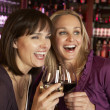 Two Women Enjoying Drink Together In Bar — 图库照片