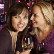 Two Women Enjoying Drink Together In Bar — Stock Photo #11893573