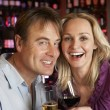 Couple Enjoying Drink Together In Bar — Stock Photo #11893590