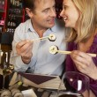 Couple Enjoying Sushi In Restaurant — ストック写真