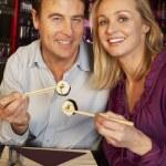Couple Enjoying Sushi In Restaurant — Stock Photo #11893644