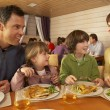 Stock Photo: Family Eating Lunch Together In Restaurant