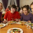Family Eating Lunch Together In Restaurant — Stock Photo #11893664