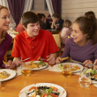 Family Eating Lunch Together In Restaurant — Stock Photo #11893666
