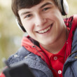 Teenage Boy Wearing Headphones And Listening To Music Wearing Wi — Stock Photo