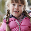 Outdoor Portrait Of Young Girl Wearing Winter Clothes — Stockfoto
