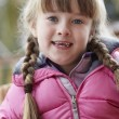 Outdoor Portrait Of Young Girl Wearing Winter Clothes — Stock fotografie