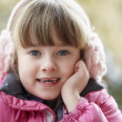 Outdoor Portrait Of Young Girl Wearing Winter Clothes And Earmuf — Stock Photo