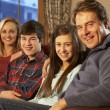 Portrait Of Family Relaxing On Sofa Together — Stock Photo #11893767