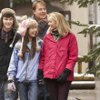 Teenage Family Walking Along Snowy Town Street In Ski Resort — Foto de Stock