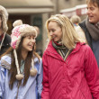 Teenage Family Walking Along Snowy Town Street In Ski Resort — Stock Photo #11893789