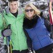 Young Couple On Ski Holiday In Mountains — Stockfoto