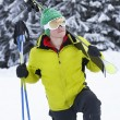 Young Man On Ski Holiday In Mountains - Foto Stock