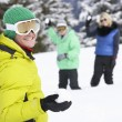 Group Of Young Friends Having Snowball Fight On Ski Holiday In M - Foto de Stock  