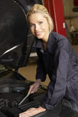 Female mechanic at work — Stock Photo