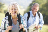 Senior couple on country walk — Foto de Stock