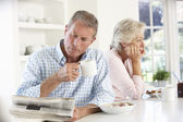 Retired couple eating breakfast — Stock Photo