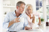 Retired couple arguing at breakfast — Stock Photo