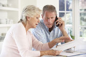 Retired couple with household bills — Stock Photo
